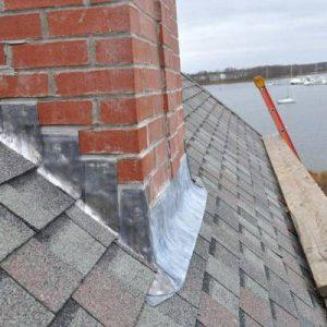 Réparer le solin de cheminée