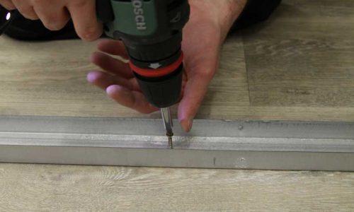 Comment poser une cloison : fixation des rails